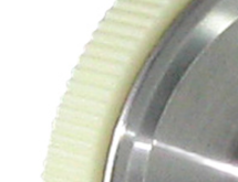 Textured plastic encoder wheel